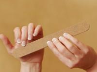 Fingernails being filed