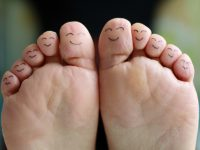 Feet with happy face drawings of different characters